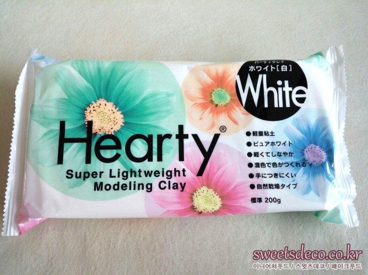 <a href=article.php?contentsno=34&lang=ko class=url target=_blank >하티(흰색)<br/>ハーティ (ホワイト) <br/>Hearty(White)</a><br/>(주)파디코 <br/> ㈱パジコ <br/> PADICO